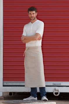 The Soho Bistro Apron is made from polyester, double-needle topstitching, contrast topstitching, reinforced stress points and patch pocket with pencil divide. Cafe Uniform, Hotel Uniform, Waiter Uniform, Staff Uniforms, Work Uniforms, Cafe Apron, Urban Trends, Podium, Uniform Design