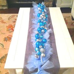 Tulle garland + ornament garland = cute coffee table runner.