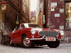 Volvo P 1800. Swiss coupe, designed in Italy and manufactured in Great Britain.  Beautiful even after 50 years!