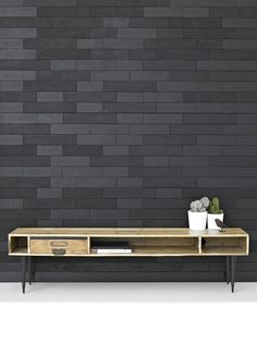 repurposed console. gorgeous black wall