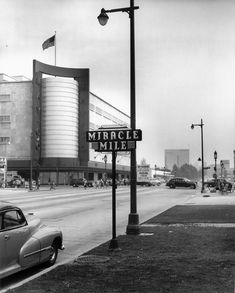 Circa 1940 view of the Miracle Mile sign on Wilshire Boulevard, with the May Company department story in the background. Courtesy of the Dick Whittington Photography Collection, USC Libraries. California History, Southern California, Vintage California, Old Photos, Vintage Photos, Usc Library, Los Angeles Area, City Of Angels, Los Angeles County