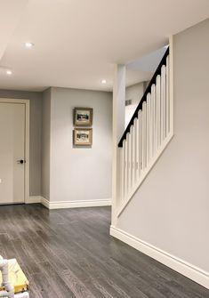 Basement staircase, Sydney Berne Mont Tremblant oil paintings, ICI Dulux Silver Cloud paint