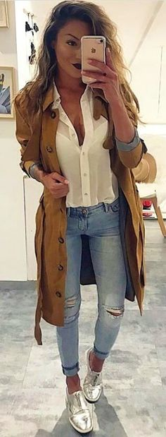 #spring #outfits woman in brown trench coat, white button-up collared shirt and distressed blue denim jeans. Pic by @vogue__vision