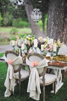Very nice flowers and chairs.