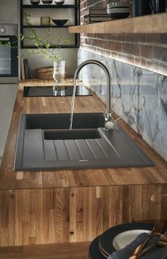 Our black granite composite sink contrasts beautifully in the solid rustic oak worktop.Our black granite composite sink contrasts beautifully in the solid rustic oak worktop. Corner Sink Kitchen, Kitchen Sink Design, Black Kitchen Cabinets, Black Kitchens, Kitchen Countertops, New Kitchen, Cool Kitchens, Kitchen Black, Best Kitchen Sinks