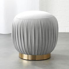 Designed by Euga Design Studio, rich velvet goes 360 with flirty folds as soft seating or stand-alone ottoman. Round brass base pulls it all together with flourish.