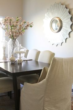 Dining Room - simple with a single, striking wall element, and simple, but pretty centerpiece