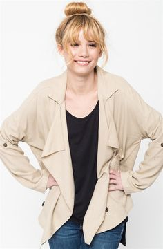 This linen jacket is a great fit for a comfortable outerwear look. With a slouchy fit and oversized pockets, this versatile look is perfect for your day in the office to a night out. Keep your shoulders in company with this linen jacket for a sophisticated and uncomplicated look. COLORS BlackLight BlueNavyTaupeOliveSIZES (This garment runs true to size) Small 0-4Medium 6-8Large 10-12Model is wearing a size Small.55% Linen, 45% Viscose.