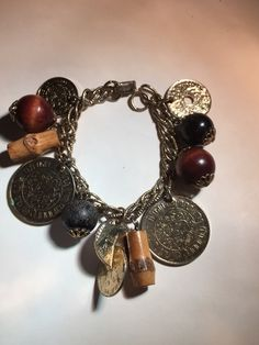 1950\'s Vintage Coro charm bracelet coin wood beads goldtone. Starting at $7