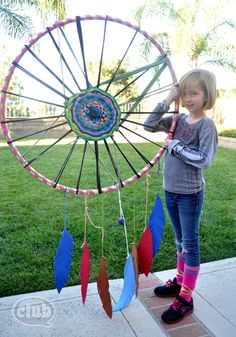 Giant hula hoop dream catcher to hang from a tree - make with cheapie hula hoop, but cover in twine or scrap leather and go for a really natural look.