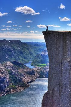 Preikestolen, also known as Pulpit Rock, just outside of Stavanger, Norway. Base jumpers often leap off this massive cliff towards the Fjord below. Lofoten, Dream Vacations, Vacation Spots, Places To Travel, Places To See, Travel Stuff, Travel Destinations, Wonderful Places, Beautiful Places
