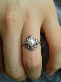 LOVE this with the pearl. Black diamonds around instead of regular diamonds would be perfect too. And a little bit different band. #weddingringspearl