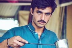 Arshad Khan, a tea seller in Islamabad, Pakistan became an Internet sensation after his photo was posted on social media.