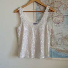 """Express sequin tank Tank by Express features a mesh base layer covered by white an cream square shaped sequins. Slightly sheer. In excellent condition with no stains or missing sequins. Measures 18"""" from pit to pit. Deep scoop neckline. Stay classy by pairing this with pants for date night or get sexy with a mini skirt for girls night out! Express Tops Tank Tops"""