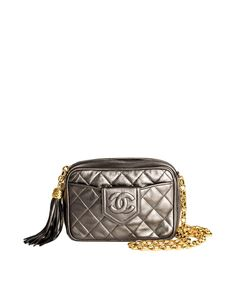416621ab4030c Chanel Vintage Grey Silver Metallic Lambskin Quilted Tassel Bag - from Amarcord  Vintage Fashion Lambskin Leather