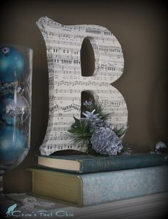 craft store paper letter - wrapped in sheet music, magazine/book pages/ newspaper, or wrapped in yarn