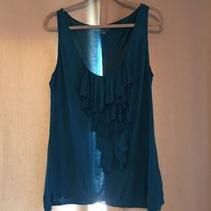 Xl blue tank top Beautiful xl  New York & company blue color with Ruffles in the middle has a soft feeling cozy comfortable fit -hardly worn New York & Company Tops Tank Tops