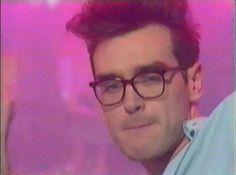 Morrissey wearing glasses