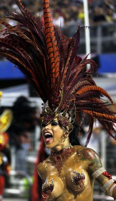 A reveller from the Gavioes da Fiel samba school takes part in the Special Group category of the annual Carnival parade in Sao Paulo's Samba...