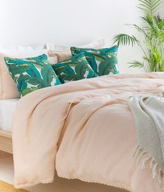 Create a relaxing retreat by adding tropical touches to a light and airy bedroom! Pillow: UL-003, LAMP: AMA-100, BEDDING: EVY-3004