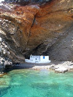 """A little """"fishermen's church"""" that was tucked away in the rock on #Santorini island, #Greece. If you take the Volcano boat tour from Fira they will take you by this church and if you are brave enough you can swim to it. There is also an option to swim in the natural hot spring generated by the nearby volcano."""