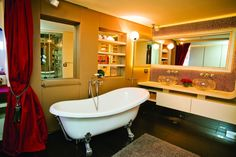 [Bathroom] : Luxury And Elegant Design Idea Bathroom With Laminate Flooring And Sweet Fur Rug Also Large Red Curtain Acrylic Bathtub With Elegant Faucets Cabinet Beautiful Couple Vessel Sinks Towel Bars And Large Bath Mirror Best Bathroom Designs, Bathroom Images, Bathroom Design Luxury, Bath Design, Vintage Bathtub, Bathroom Colors, Bathroom Furniture, Amazing Bathrooms, Interior Decorating
