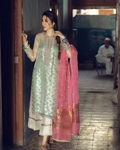Tabeer Pure silk embossed organza shirt embellished in golden threaded maroori cladded in appliqué patches on hem line paired with Begonia… Desi Wedding Dresses, Pakistani Formal Dresses, Shadi Dresses, Nikkah Dress, Pakistani Dress Design, Indian Dresses, Indian Long Frocks, Pakistani Fashion Party Wear, Pakistani Wedding Outfits