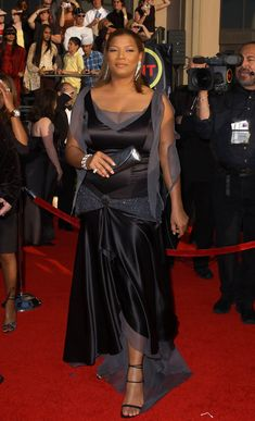 Lady in Waiting - The Queen was perfectly lovely in this black satin and charcoal chiffon gown at the 2003 Screen Actors Guild Awards. But, she did show herself to be something of a sartorial novice by standing on the dress's train as posed on the red carpet. Whoops!