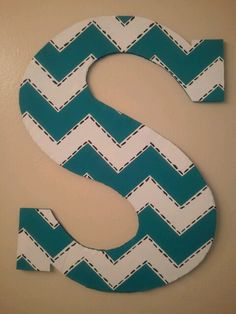 Cut out a cardboard letter and paint