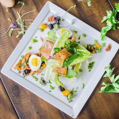 [Photo By: studiopri.com] Our Citrus Cured Salmon Nicoise is our #healthy take on a #classic, made with baby greens, sweet potatoes, green beans, cured olives, crispy capers, soft boiled eggs, and cherry tomatoes  #dirt #dirteatclean #eatatdirt #eatdirt #eatdirtlivelonger #comingsoon