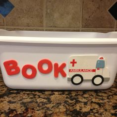 Book ambulance :) Great idea as your fourth grades can sometimes be rough on those books!