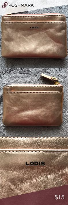 "LODIS Leather RFID Coin Purse Not all cards contain RFID contactless technology - this product only helps protect cards with RFID contactless technology. Front and back slip pockets, zip closure, goldtone hardware, RFID technology. Approximate measurements: Coin purse 5-1/4""W x 3-1/2""H x 1/8""D Shell 100% leather; lining 100% polyester twill Imported Lodis Bags Wallets"
