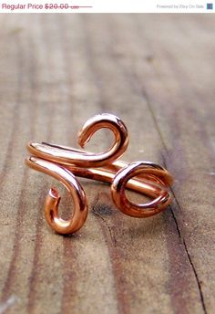 This simple little swirled open infinity love knot ring is done in bright copper wire. Suitable for men, women, unisex.    Ring Size 5 Adjustable    This is a OOAK ( one of a kind ) and is ready to ship.    Have any questions? Contact the shop owner. $20.00