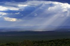 Sun rays through clouds - Addo Landscape Sun rays through clouds - Addo is a town in Sarah Baartman District Municipality in the Eastern Cape province of South Africa. Region east of the Sundays River, some 72 km northeast of Port Elizabeth.