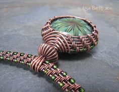 This looks like Lisa Barth's style.  Beautiful! woven wire jewelry | Jewelry ~ WIRE WRAP / Woven Copper Collar for the Woven Bezel Pendant