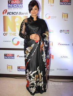 Divya Dutta wore a black printed sari with a sheer long-sleeved blouse at the Times Now, ICICI NRI awards.