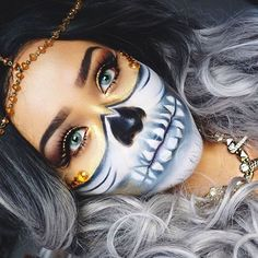 Touch of glam, touch of skull ✨ For this #NYXHalloween half-skull look, @alvajay put her own gold twist on the @Chrisspy classic She used our Matte Liquid Liner for this look ✔ Tell us what you'll be for Halloween in the comments below! || #nyxcosmetics #NYXHalloween