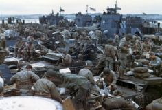 """Local Identifier: 111-SC-1214, """"Men and equipment are massed together in landing craft in preparation for the big assault on the European continent.  England."""" (US National Archives)"""