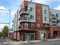Exterior View - Studio/1BA Condo on the top floor in the heart of Greenwood. Open floor plan, kitchen & living room together. Laminate flooring, granite counter tops, stainless steel appliances, walk-in closet. Secured entry to building featuring lobby, game room, exercise room, bike room and 2nd floor community terrace with BBQ's and & dog park. $1050/month. 424 N 85th St Apt 405, Seattle, WA