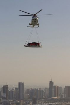 In Dubai helicopters fly cars regularly across the city. Bizarre Things You'd Only See In Dubai - Illumeably Dubai Things To Do, Dubai Cars, Meanwhile In, United Arab Emirates, Abu Dhabi, Night Life, Super Cars, Cool Pictures, Travel Destinations