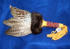 A well made prayer fan with duel pheasant wings, fox fur and a leather wrapped, bead wrapped handle with fringed leather bottom. Native American made with certificate of authenticity $79.95 w/ free shipping #regalia #fan #nativeamerican