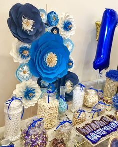 Royal blue, Navy blue, baby blue white and gold paper floral sweet table backdrop made for a baby boy 1st birthday celebration. by Prettypartyflowers. For more creations follow @prettypartyflowers on Facebook and Instagram.
