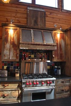 traditional kitchen by KPD Interiors Same rustic kitchen with leather pulls and look at the beautiful range! Kitchen Hoods, Kitchen Stove, Kitchen Appliances, Rustic Kitchen Cabinets, Kitchen Decor, Kitchen Ideas, Kitchen Inspiration, Stove Vent, Cabin Kitchens