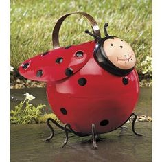 """Cheery ladybug watering can adds a pop of color to the garden in the brightest red! Handcrafted, handpainted metal with a glossy finish. Easy carry handle. 9"""" high.From his bright red cockscomb to his"""