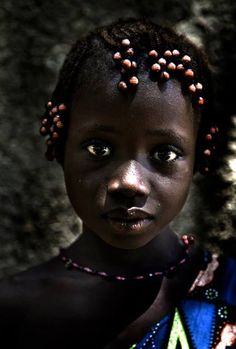 Pretty with beads! I remember having beads on my braids when I was young! African Portraits   ©Quim Fàbregas