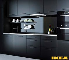 Ikea Kitchen · Black (Imagine THESE cabinets in a garage! Black Ikea Kitchen, Loft Kitchen, Kitchen Room Design, Black Kitchen Cabinets, Luxury Kitchen Design, Contemporary Kitchen Design, Kitchen Cabinet Design, Black Kitchens, Home Decor Kitchen