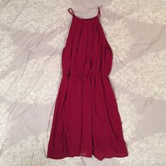 WINDSOR Halter Dress Gorgeous burgundy halter-style dress. Very light and flowy, as shown in the picture. Has a slit down the upper back. Only worn twice, great condition! WINDSOR Dresses Mini