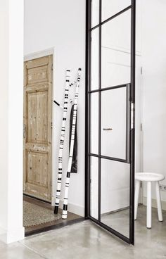 Look at the black and white poles for hanging clothes. Copy the look. The black can be washi or electrical tape.