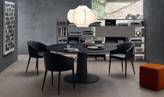 Rounde table in black with frosted lacquered glass top 4 Fascinating Tables for the Stylish Contemporary Home