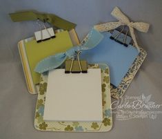 chipboard coaster, binder clip, post its
